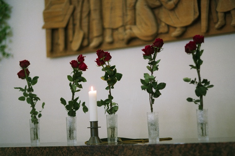 Red roses on a church altar.