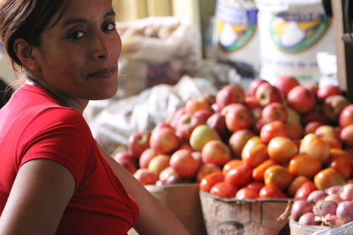A woman selling fruits abroad.