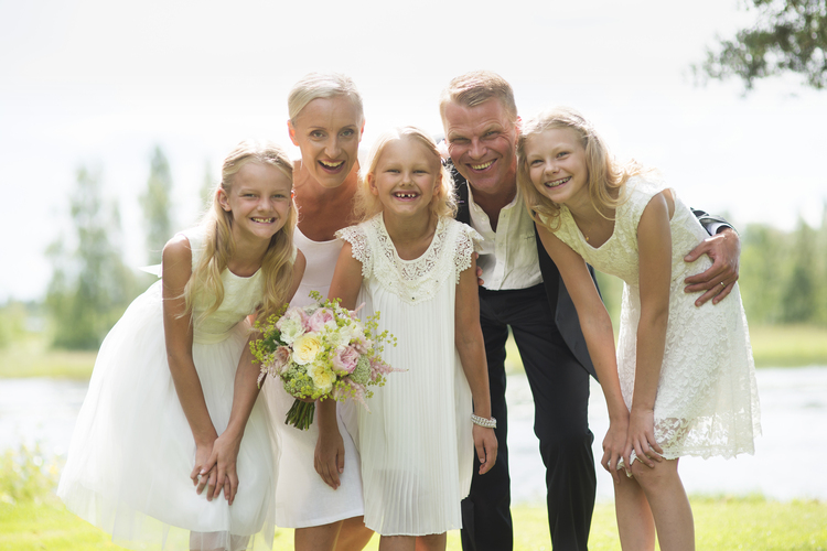Wedding couple with flower girls.